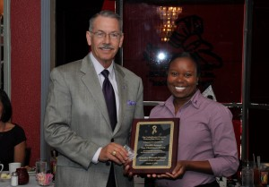 Jim presents 12th Annual Trey Hutchison Award to Shreveport Police Corporal Shaunda Holmes.